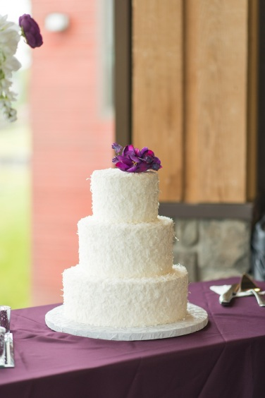 Cakes by Frosted Custom Coconut Simple Floral Wedding Cake Wide Shot View More: http://jphinneyphotography.pass.us/derekallyson